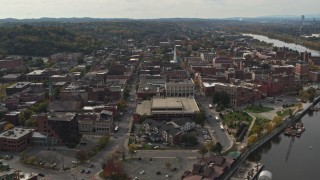 DX0002_216_003 - 5.7K stock footage aerial video ascend and orbit the downtown area of Troy, New York