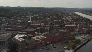 DX0002_216_004 - 5.7K stock footage aerial video descend and orbit the downtown area of Troy, New York