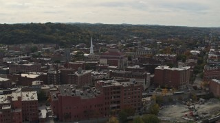 DX0002_216_005 - 5.7K stock footage aerial video of a reverse view of the downtown area of Troy, New York