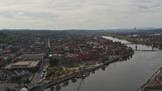 DX0002_216_006 - 5.7K stock footage aerial video of flying away from the downtown area of Troy, New York by the Hudson River