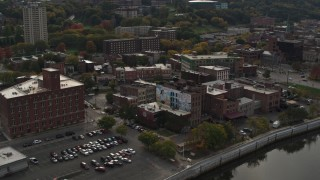DX0002_216_007 - 5.7K stock footage aerial video of orbiting brick offices and shops in the downtown area of Troy, New York