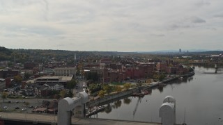 DX0002_216_009 - 5.7K stock footage aerial video wide view of the downtown area of Troy, New York, descend and reveal bridge