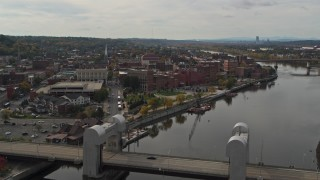 DX0002_216_010 - 5.7K stock footage aerial video ascend from bridge for wide view of the downtown area of Troy, New York