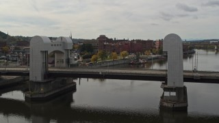 DX0002_216_012 - 5.7K stock footage aerial video fly over bridge and river toward the downtown area of Troy, New York