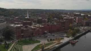 DX0002_216_013 - 5.7K stock footage aerial video flying by park, music hall and brick buildings the downtown area of Troy, New York