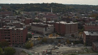 DX0002_216_014 - 5.7K stock footage aerial video flying away from music hall and brick buildings the downtown area of Troy, New York