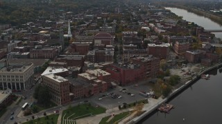 DX0002_216_015 - 5.7K stock footage aerial video orbit brick buildings the downtown area of Troy, New York, reveal riverfront park
