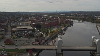 DX0002_216_017 - 5.7K stock footage aerial video reverse view of the downtown area of Troy, New York, and riverfront park