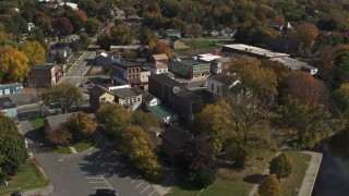 DX0002_216_027 - 5.7K stock footage aerial video fly over the river toward a small town, Fort Edward, New York