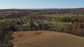 DX0002_216_030 - 5.7K stock footage aerial video of orbiting the small town of Fort Ann, New York, seen from corn fields