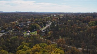 DX0002_216_031 - 5.7K stock footage aerial video of a wide orbit of the small town of Fort Ann, New York
