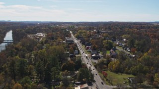 DX0002_216_034 - 5.7K stock footage aerial video orbiting George Street through the small town of Fort Ann, New York