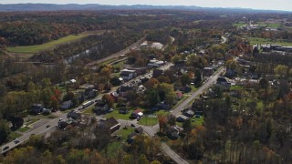 DX0002_216_035 - 5.7K stock footage aerial video of an orbit of George Street through the small town of Fort Ann, New York