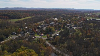 DX0002_216_036 - 5.7K stock footage aerial video fly away from and orbit the small town of Fort Ann, New York