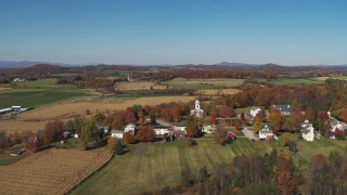DX0002_217_003 - 5.7K stock footage aerial video approach a church in the small town of Orwell, Vermont, farm fields in background