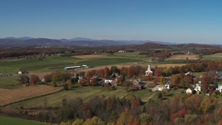 DX0002_217_004 - 5.7K stock footage aerial video reverse view of a church and farm fields in the small town of Orwell, Vermont