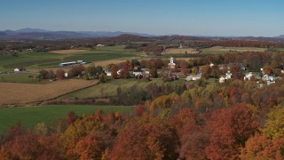 DX0002_217_005 - 5.7K stock footage aerial video orbit farm fields and the small town of Orwell, Vermont