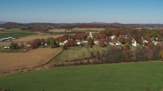DX0002_217_006 - 5.7K stock footage aerial video approach and orbit farm fields around the small town of Orwell, Vermont