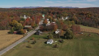 DX0002_217_013 - 5.7K stock footage aerial video circling Main Street in a small town in autumn, Orwell, Vermont