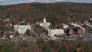 DX0002_218_003 - 5.7K stock footage aerial video of a reverse view of the state capitol building and downtown in Montpelier, Vermont