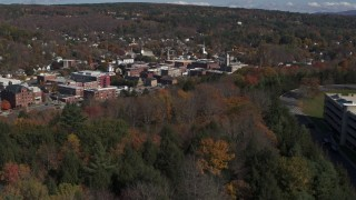 DX0002_218_009 - 5.7K stock footage aerial video of the downtown area of the city seen from a parking garage on a hill, Montpelier, Vermont