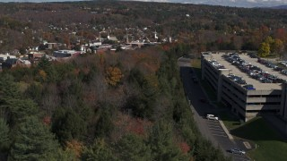DX0002_218_010 - 5.7K stock footage aerial video of downtown seen from a parking garage on a hill, Montpelier, Vermont