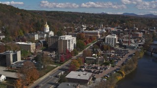 DX0002_218_015 - 5.7K stock footage aerial video fly away from government office and state capitol building, reveal river, Montpelier, Vermont