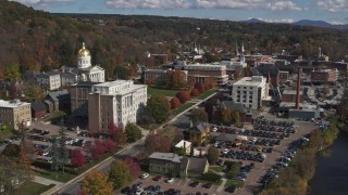 DX0002_218_017 - 5.7K stock footage aerial video reverse view of government office and state capitol building near the river, Montpelier, Vermont