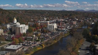 DX0002_218_020 - 5.7K stock footage aerial video fly away from government offices and smoke stack by capitol and the river, Montpelier, Vermont