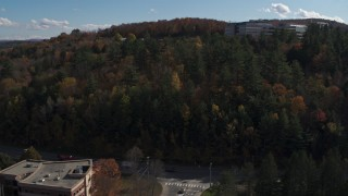 DX0002_218_021 - 5.7K stock footage aerial video of approaching an office building on a hill, Montpelier, Vermont