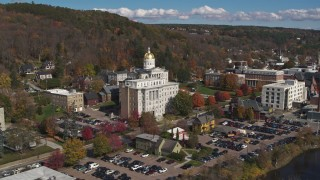 DX0002_218_024 - 5.7K stock footage aerial video reverse view of government office building and state capitol building, Montpelier, Vermont