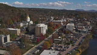 DX0002_218_025 - 5.7K stock footage aerial video orbit government office building and state capitol, fly away from downtown, Montpelier, Vermont
