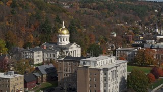 DX0002_218_037 - 5.7K stock footage aerial video of the state capitol dome behind a government office building, Montpelier, Vermont
