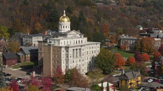 DX0002_218_039 - 5.7K stock footage aerial video descend by a government office building, capitol dome behind it, Montpelier, Vermont