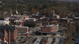 DX0002_218_045 - 5.7K stock footage aerial video of passing office buildings beside the river, Montpelier, Vermont