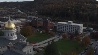 DX0002_219_011 - 5.7K stock footage aerial video of flying away from government office building and the capitol in Montpelier, Vermont