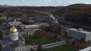 DX0002_219_012 - 5.7K stock footage aerial video of government and brick office buildings near the river in Montpelier, Vermont