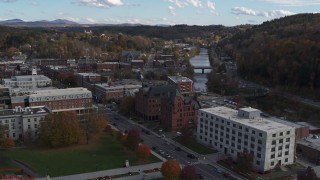 DX0002_219_013 - 5.7K stock footage aerial video descend with view of government and brick office buildings near the river in Montpelier, Vermont