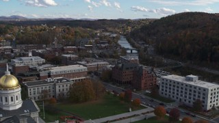 DX0002_219_014 - 5.7K stock footage aerial video ascend with view of government and brick buildings near the river, reveal capitol, Montpelier, Vermont