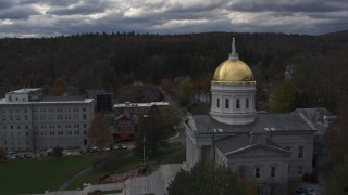 DX0002_219_023 - 5.7K stock footage aerial video reverse view of the golden dome and front steps of the capitol building, Montpelier, Vermont