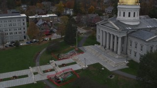 DX0002_219_027 - 5.7K stock footage aerial video orbiting people walking up the front steps of the capitol building, Montpelier, Vermont