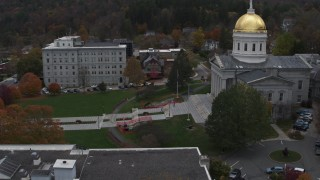 DX0002_219_028 - 5.7K stock footage aerial video of flying away from people walking up the front steps of the capitol building, Montpelier, Vermont