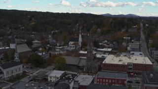 DX0002_219_035 - 5.7K stock footage aerial video approach church steeples and downtown buildings, Montpelier, Vermont