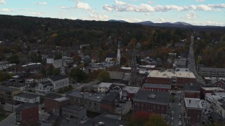 DX0002_219_038 - 5.7K stock footage aerial video of orbiting church steeples and downtown buildings, Montpelier, Vermont