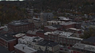 DX0002_219_042 - 5.7K stock footage aerial video orbit and fly away from city hall in downtown, Montpelier, Vermont