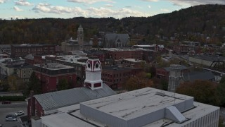 DX0002_219_046 - 5.7K stock footage aerial video fly over US Postal Service building to approach city hall in downtown, Montpelier, Vermont