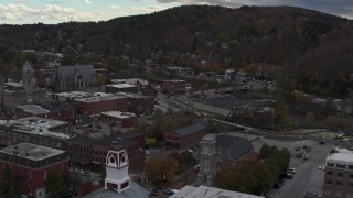 DX0002_219_048 - 5.7K stock footage aerial video of flying by city hall and buildings by the river in downtown, Montpelier, Vermont