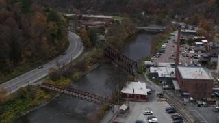 DX0002_219_056 - 5.7K stock footage aerial video approach, orbit, and fly away from bridges spanning the Winooski River, Montpelier, Vermont