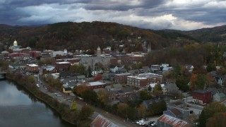 DX0002_220_010 - 5.7K stock footage aerial video of a wide orbit of city hall and brick buildings at sunset, Montpelier, Vermont