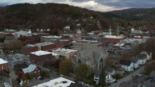 DX0002_220_012 - 5.7K stock footage aerial video approach and orbit city hall and brick buildings at sunset, Montpelier, Vermont